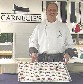 Anthony Egan, Executive Chef at Carnegie's shows a lovely tray of chocolate covered strawberries.