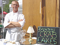 Lindsay's on Liberty's Sous Chef Brian Anderson served crab cakes at the Taste of Peoria, 2002.
