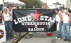 The smiling ranch hands of Lone Star Steakhouse & Saloon brought their famous ribs to downtown Peoria.