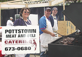 Bob and Katie of Pottstown Meat & Deli (and another chef) grill Black Forest Pork Chops. They also served Original Beef Sticks.