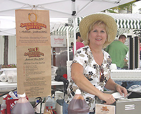 Lisa Moser of The Q Smokehouse Buffet serves Hickory Smoked Pulled Pork, and Homemade Apple Cobbler.