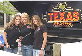 A pretty Texas Roadhouse trio was on hand to serve ribs and marinated beef skewer.